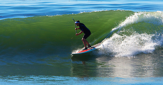 Learn to paddleboard surf